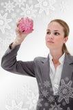 Zusammengesetztes Bild des Bankangestellten genauen Blick in Sparschwein werfend Lizenzfreie Stockfotos