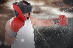 Zusammengesetztes Bild des Boxertragenden Hauptschutzes und -handschuhe Stockbild