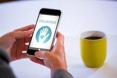 Zusammengesetztes Bild des digital zusammengesetzten Bildes des freiwilligen Textes mit Ikonen Lizenzfreie Stockbilder