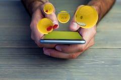 Zusammengesetztes Bild des dreidimensionalen Bildes von smiley stellt Reaktionen 3d gegenüber Lizenzfreies Stockfoto