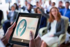 Zusammengesetztes Bild des freiwilligen Textes mit Ikonen auf Schirm Stockfoto