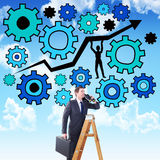 Zusammengesetztes Bild des Geschäftsmannes schauend auf einer Leiter Lizenzfreies Stockbild