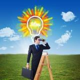 Zusammengesetztes Bild des Geschäftsmannes schauend auf einer Leiter Lizenzfreies Stockfoto