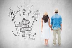 Zusammengesetztes Bild des glücklichen Hippie-Paarhändchenhaltens Lizenzfreies Stockfoto