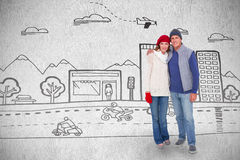 Zusammengesetztes Bild des glücklichen Paars in der warmen Kleidung Lizenzfreie Stockfotos