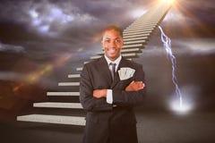 Zusammengesetztes Bild des hübschen Geschäftsmannes mit Dollar in einer Tasche 3d Stockbilder
