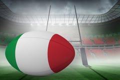 Zusammengesetztes Bild des italienischen Flaggenrugbyballs Lizenzfreie Stockfotos