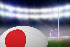 Zusammengesetztes Bild des japanischen Flaggenrugbyballs Stockfotos
