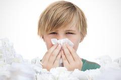 Zusammengesetztes Bild des kranken kleinen Jungen mit einem Taschentuch Lizenzfreies Stockbild