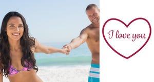 Zusammengesetztes Bild des lächelnden Paarhändchenhaltens Lizenzfreies Stockfoto