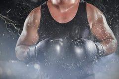 Zusammengesetztes Bild des mittleren Abschnitts des muskulösen Boxers Lizenzfreies Stockbild