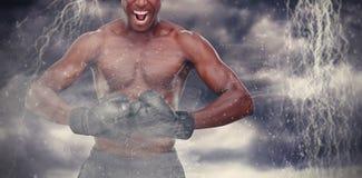 Zusammengesetztes Bild des muskulösen Boxers Stockfotos