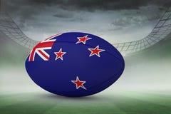 Zusammengesetztes Bild des Neuseeland-Flaggenrugbyballs Stockbild