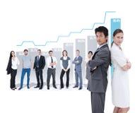 Zusammengesetztes Bild des Porträts der Geschäftsleute, die Rücken an Rücken stehen Lizenzfreie Stockfotos
