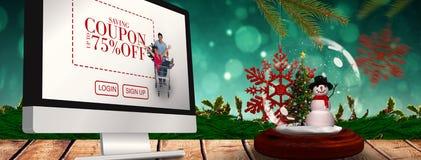 Zusammengesetztes Bild des Schneemann- und Weihnachtsbaums in der Schneekugel Stockfotos