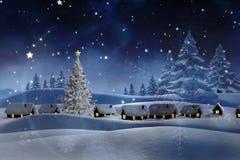 Zusammengesetztes Bild des Schnees bedeckte Dorf Lizenzfreies Stockfoto