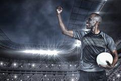 Zusammengesetztes Bild des Sportlers mit der geballten Faust nach Sieg Lizenzfreies Stockfoto