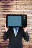 Zusammengesetztes Bild des versteckenden Kopfes des Geschäftsmannes mit einem Kasten Stockbilder