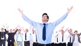 Zusammengesetztes Bild des zujubelnden Geschäftsmannes mit seinen Armen oben angehoben Stockfoto