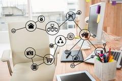 Zusammengesetztes Bild Digital von Ikonen im Büro Lizenzfreies Stockfoto