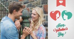 Zusammengesetztes Bild von bereitstehenden Geländern der jungen Paare der Hüfte Lizenzfreie Stockfotografie