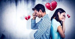 Zusammengesetztes Bild von den deprimierten Paaren, die zurück zu Rückseite stehen Stockfotografie