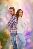 Zusammengesetztes Bild von den deprimierten Paaren, die zurück zu Rückseite stehen Lizenzfreie Stockbilder