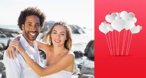 Zusammengesetztes Bild von den herrlichen Paaren, die durch die Küste umfassen Lizenzfreies Stockfoto
