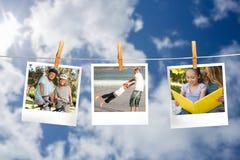 Zusammengesetztes Bild von den sofortigen Fotos, die an einer Linie hängen Lizenzfreies Stockbild