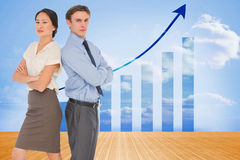 Zusammengesetztes Bild von Geschäftskollegen mit den Armen kreuzte im Büro Lizenzfreie Stockfotos