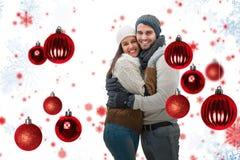 Zusammengesetztes Bild von jungen Winterpaaren Stockfotos