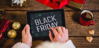 Zusammengesetztes Bild von schwarzem Freitag mit grünen Weihnachtsikonen Stockfotografie