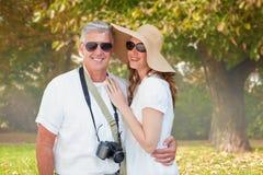 Zusammengesetztes Bild von Urlaub machenden Paaren Lizenzfreies Stockfoto