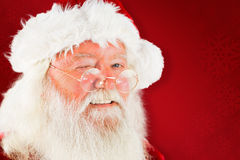 Zusammengesetztes Bild von Weihnachtsmann-Blinzeln Stockfotos