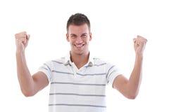 Zusammenpressende Fäuste des glücklichen Mannes Lizenzfreies Stockfoto