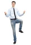 Zusammenpressende Fäuste des glücklichen Mannes Stockbild