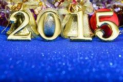 Zusammensetzung des neuen Jahres mit Gold nummeriert 2015-jähriges Stockbild
