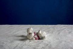 Zusammensetzung eines Spielzeugs und des Sandes Stockfoto
