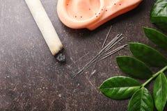 Zusammensetzung mit Akupunkturversorgungen stockbild