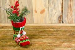 Zusammensetzung mit einer Weihnachtssocke Weihnachtsstrumpfstand auf a Stockfoto
