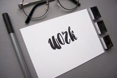 Zusammensetzung mit Wort ` Arbeit ` geschrieben in Kalligraphieart Lizenzfreies Stockfoto