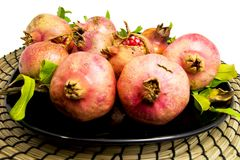 Zusammensetzung von den pomegrantes benutzt als Tabellenmeisterwerk Für Herbst diy Konzepte des Falles und des Ausgangs Stockfotografie