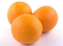 Zusammensetzung von drei Orangen Lizenzfreie Stockfotos