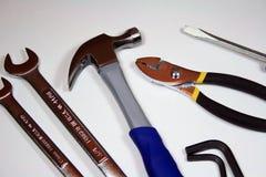 Zusammenstellung von den Werkzeugen lokalisiert auf Weiß lizenzfreie stockbilder