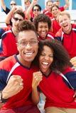 Zuschauer in Team Colors Watching Sports Event Stockfotografie