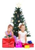 Zusters bij Kerstboom Royalty-vrije Stock Afbeeldingen