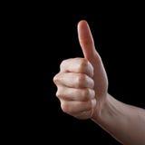 Zustimmungsdaumen oben wie das Zeichen als kaukasisches Handzeichen lokalisiert über Schwarzem Stockfotografie