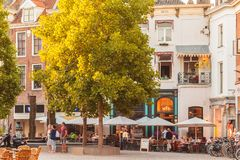 Restaurants with people on the Houtmarkt central square in Zutph Royalty Free Stock Image