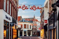 Shopping street with christmas lights in the city center of Zutphen, The Netherlands. Zutphen, The Netherlands - November 18, 2018: Shopping street with royalty free stock images