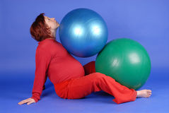 Zuzana with balls. Exercise with balls in late pregnancy Royalty Free Stock Images